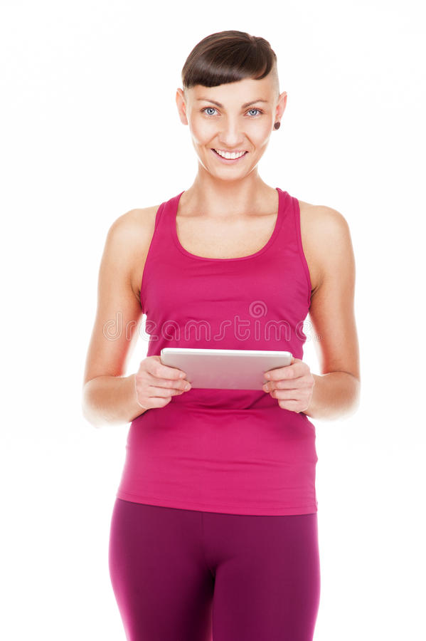 Portriat of woman with tablet, Isolated on white background. Smiling at camera. royalty free stock image