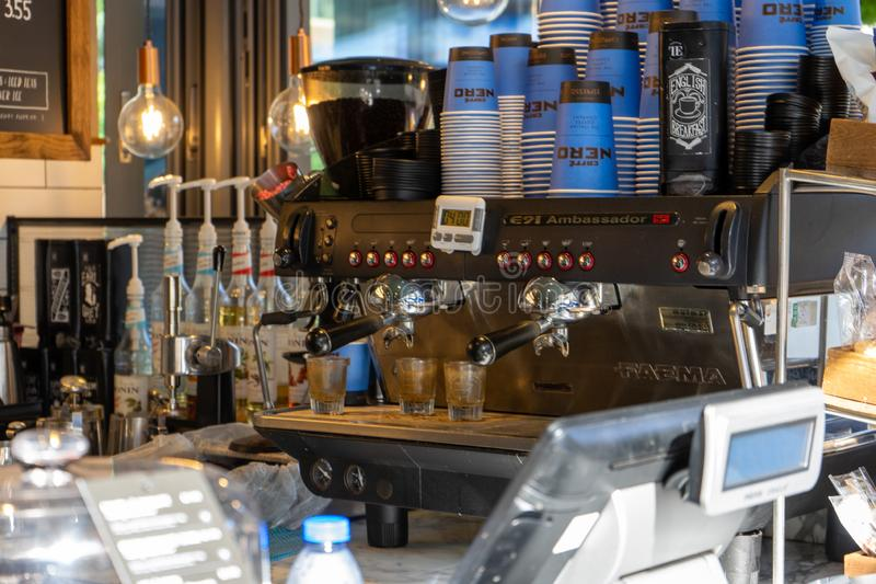 An industrial coffee making machine inside a cafe nero coffee shop. 10/09/2019 Portsmouth, Hampshire, UKAn industrial coffee making machine inside a cafe nero stock photography