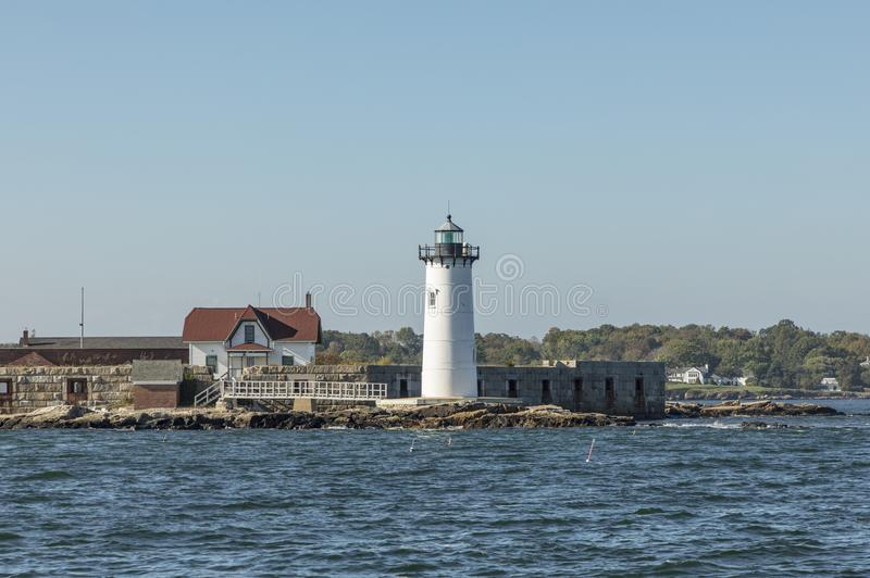 Portsmouth Harbor Lighthouse and Fort Constitution State Historic Site view in summer, New Hampshire, USA royalty free stock photo