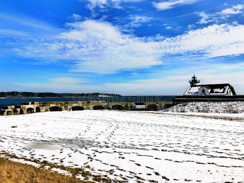 Portsmouth Harbor Lighthouse with snow. Portsmouth Harbor Lighthouse is a historic lighthouse located within Fort Constitution in New Castle, New Hampshire royalty free stock images