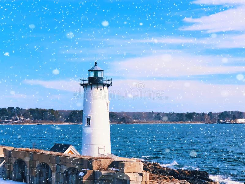 Portsmouth Harbor Lighthouse with snow. Portsmouth Harbor Lighthouse is a historic lighthouse located within Fort Constitution in New Castle, New Hampshire stock image