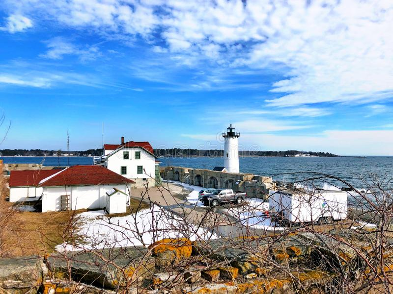 Portsmouth Harbor Lighthouse with snow. Portsmouth Harbor Lighthouse is a historic lighthouse located within Fort Constitution in New Castle, New Hampshire royalty free stock photos