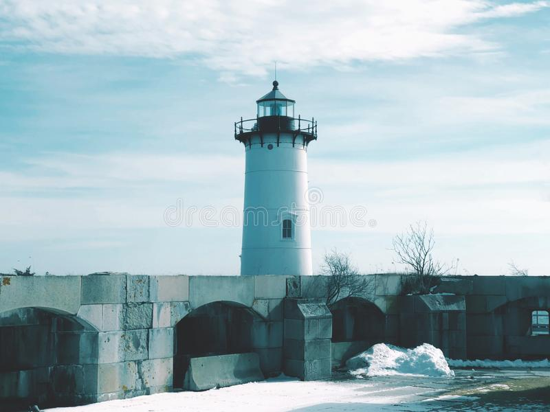 Portsmouth Harbor Lighthouse with snow. Portsmouth Harbor Lighthouse is a historic lighthouse located within Fort Constitution in New Castle, New Hampshire royalty free stock photo
