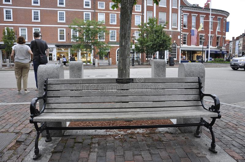 Portsmouth, 30th June: Memorial Wooden Bench from Downtown of Portsmouth in New Hampshire of USA. Memorial Wooden Bench from Downtown of Portsmouth in New stock images