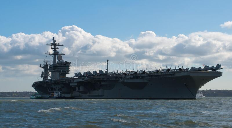 Portsmouth, United Kingdom - March 26, 2015: USS Theodore Roosevelt anchored in the Solent off Portsmouth on its five day visit to. The USS Theodore Roosevelt stock photo