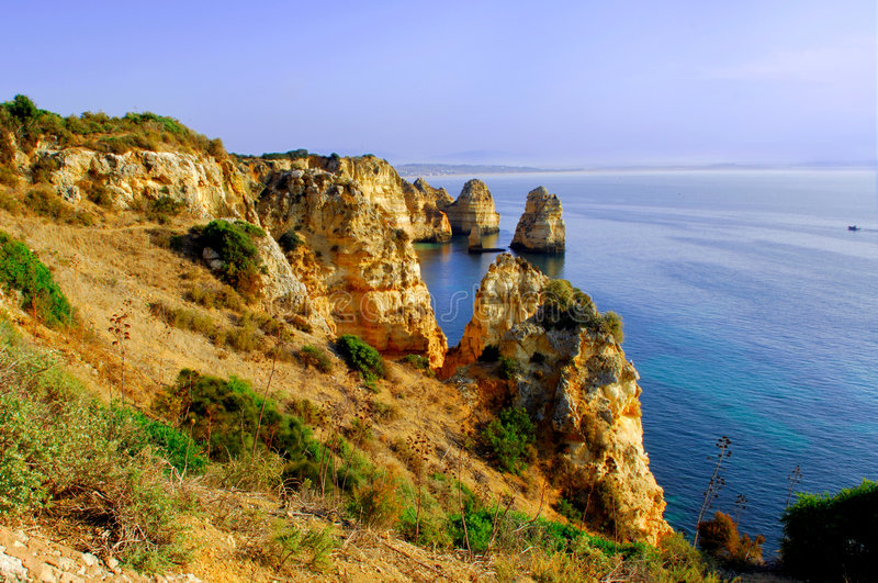 Portugal, area of Algarve, Lagos: rocky coastline royalty free stock images