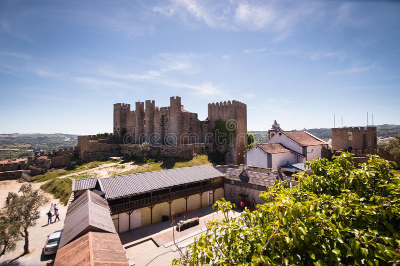 Portugal_Castle. An old castle and tourism sight in portugal near Lisbon. With hills and wide land in the background and trees and open space in the foreground royalty free stock photography