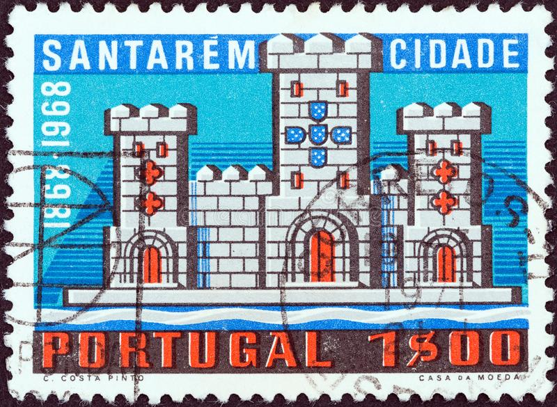 PORTUGAL - CIRCA 1970: A stamp printed in Portugal shows Castle from arms of Santarem, circa 1970. royalty free stock photo