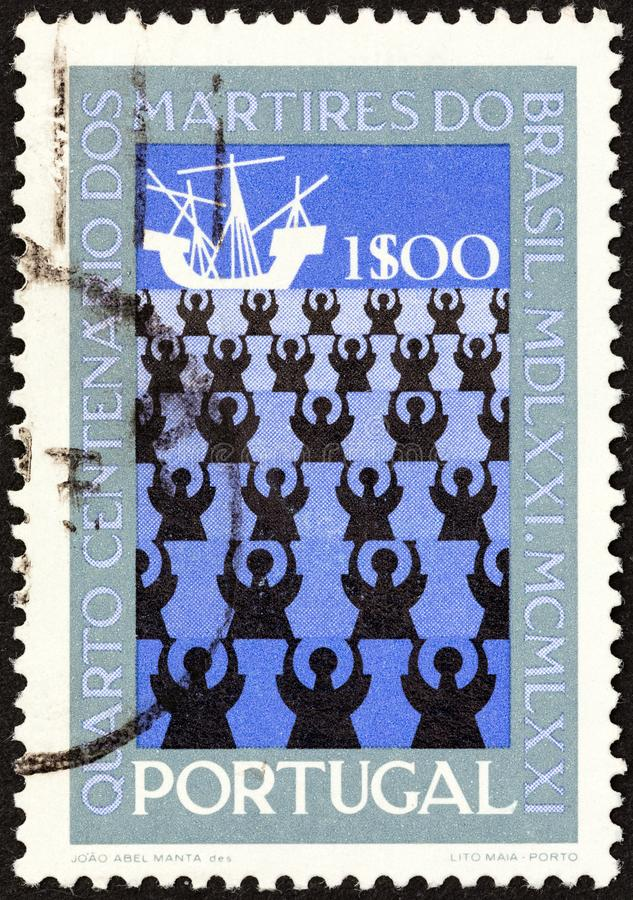 PORTUGAL - CIRCA 1971: A stamp printed in Portugal shows drowning Missionaries, circa 1971. PORTUGAL - CIRCA 1971: A stamp printed in Portugal issued for the stock image