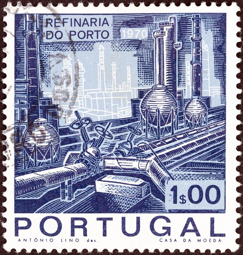 PORTUGAL - CIRCA 1970: A stamp printed in Portugal shows Distillation Plant and Pipelines, circa 1970. royalty free stock photo
