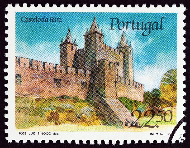 PORTUGAL - CIRCA 1986: A stamp printed in Portugal shows Feira castle, circa 1986. stock image