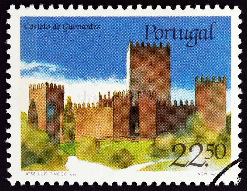 PORTUGAL - CIRCA 1986: A stamp printed in Portugal shows Guimaraes castle, circa 1986. PORTUGAL - CIRCA 1986: A stamp printed in Portugal from the `Portuguese royalty free stock image