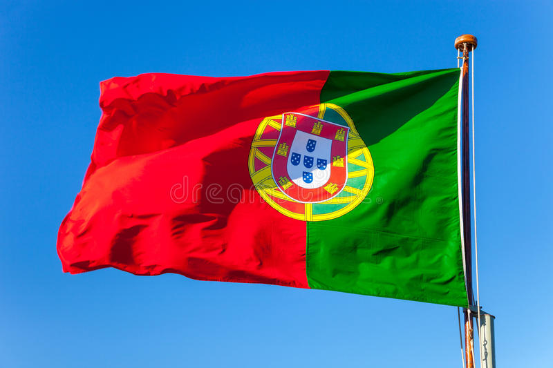 Portugal flag on blue sky. The Portugal national flag flying in the wind royalty free stock photography