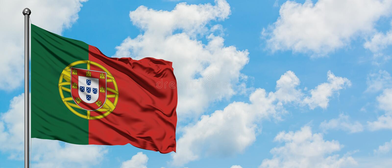 Portugal flag waving in the wind against white cloudy blue sky. Diplomacy concept, international relations.  stock images