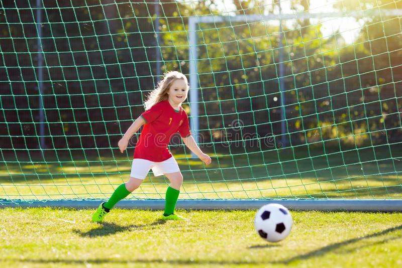Portugal football fan kids. Children play soccer. stock photo