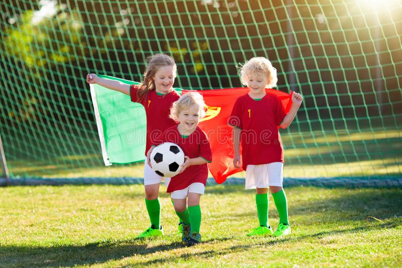 Portugal football fan kids. Children play soccer royalty free stock photography