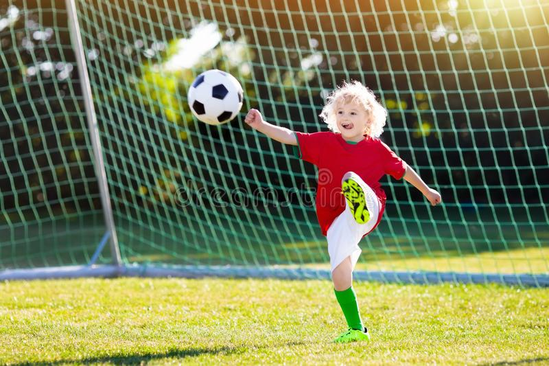 Portugal football fan kids. Children play soccer. royalty free stock photo