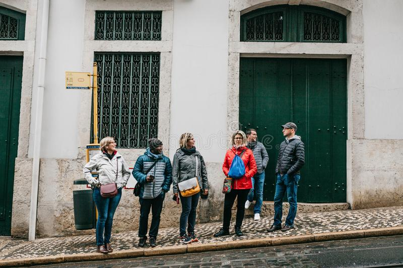 Portugal, Lisbon, April 10, 2018: People at the bus stop waiting for transport. Ordinary city life stock photo