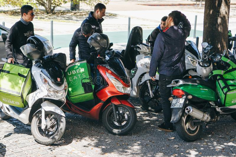 Portugal, Lisbon 29 april 2018: workers Uber Eats on the scooter delivers food to customers. royalty free stock images