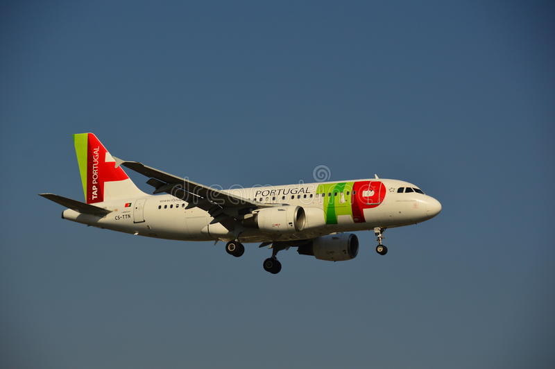 Portugal TAP - Airlines plane. This is a view of Portugal TAP - Airlines plane landing over the Chopin Airport in Warsaw. October 6, 2014. Warsaw Chopin Airport stock photography