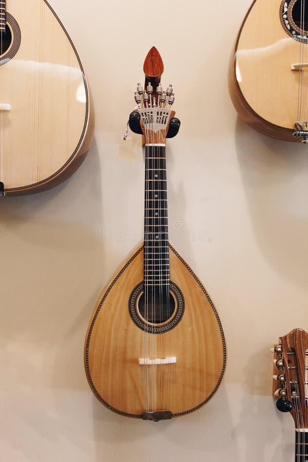 Portugese gitaar op de muur royalty-vrije stock foto's