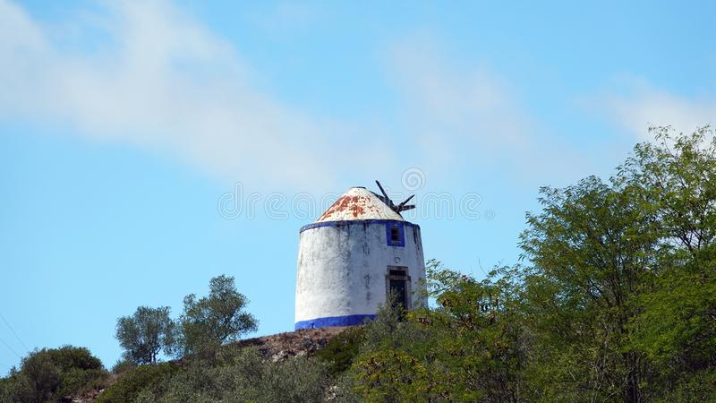 Portugese windmill at fortified medieval town Obidos in Portugal royalty free stock photography