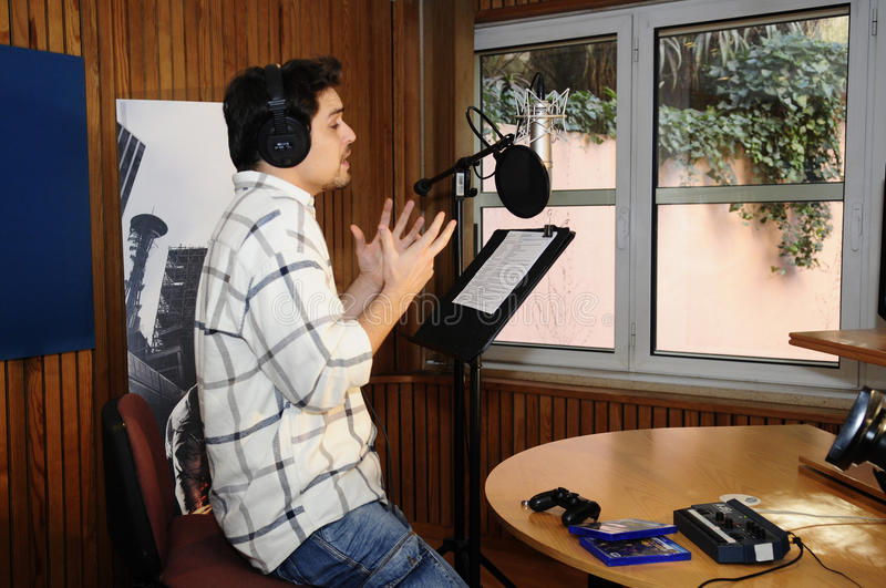 Actor at Recording Studio - Radio Booth - Voice. Portuguese actor Diogo Morgado giving voice to Delsin Rowe for the new version of inFAMOUS: Second Son, for royalty free stock photo