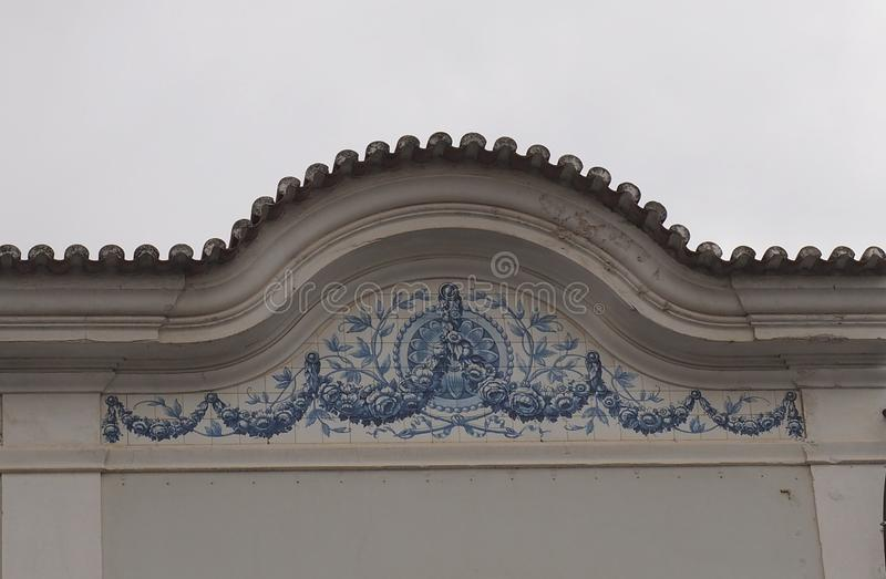 Portuguese Architecture In Loule Portugal. With arch and blue and white tiles royalty free stock images