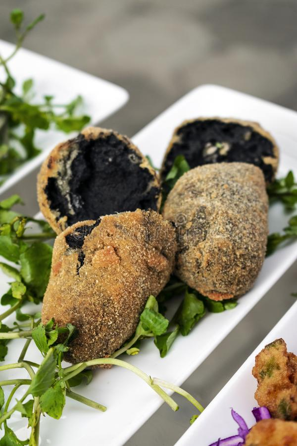 Portuguese black ink cuttlefish fried croquettes snack food. Starter stock photo