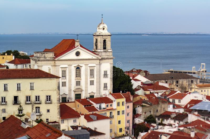 Portuguese church and typical portuguese houses with river on the background.  royalty free stock photo