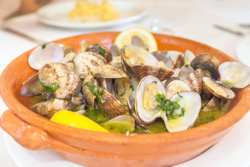 Portuguese Clams in Garlic Sauce. Amêijoas à Bulhão Pato stock photo