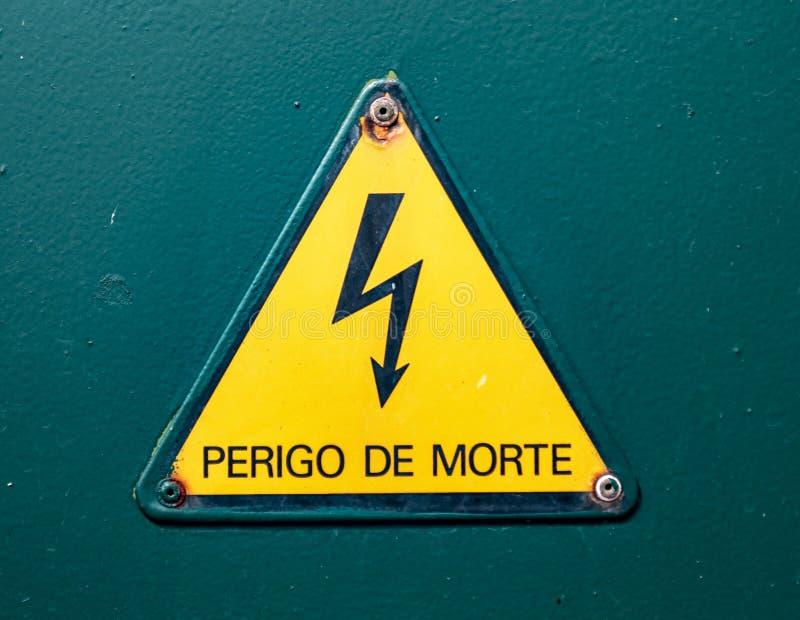 Danger warning sign. A portuguese danger warning sign stock photography