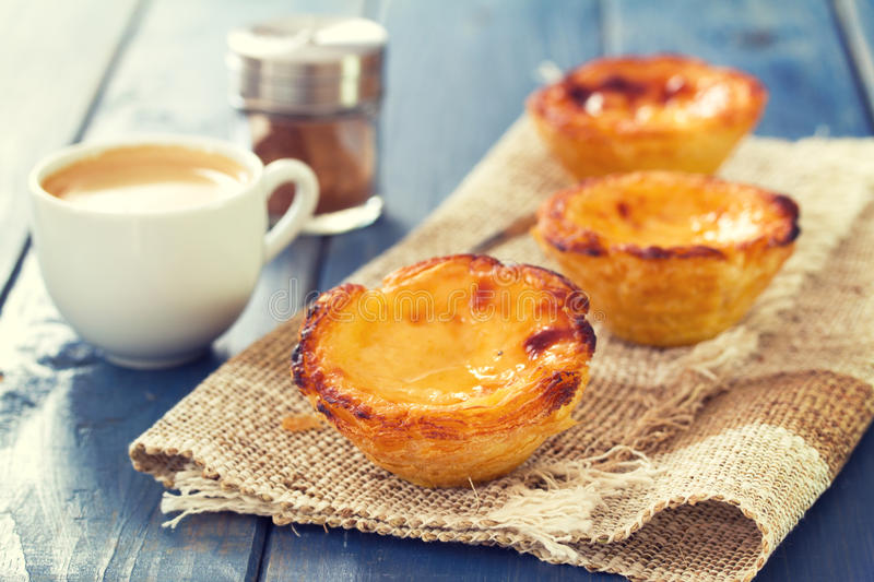 Portuguese dessert pastel de nata. With cup of coffee royalty free stock photos