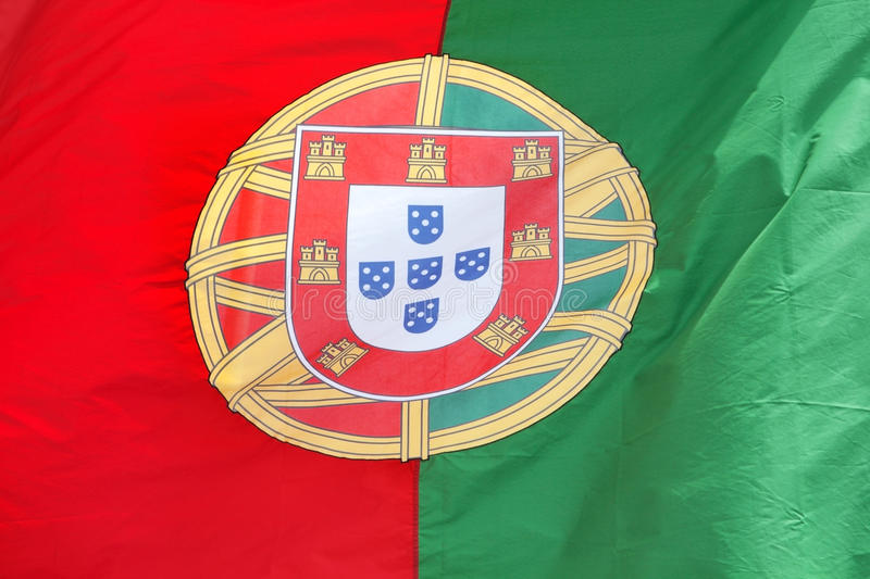 Portuguese flag in the wind. royalty free stock photos