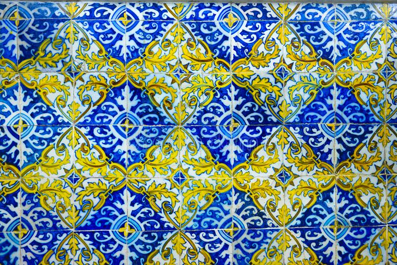 Portuguese Handmade Tiles, Blue, Yellow, White, Textures, Arts. Detail of a church interior wall with Portuguese handmade tiles, painted in blue and yellow with stock photo