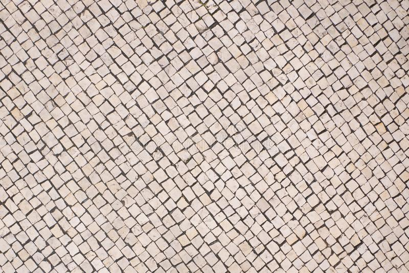Portuguese pavement / sidewalk top down view. Traditional Portuguese pavement / sidewalk top down view. Rustic background texture stock image