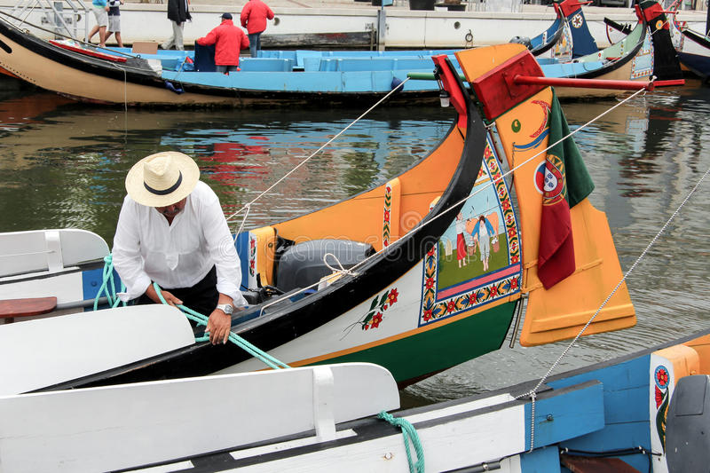 Portuguese sailor mooring traditional moliceiro boat in Aveiro, royalty free stock image