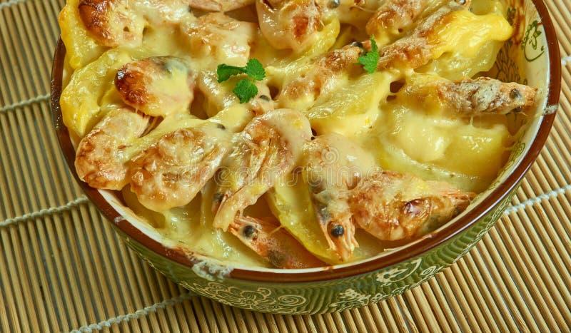 Portuguese Shrimp  Potato Gratin. De batatas gratinadas com camarao stock image