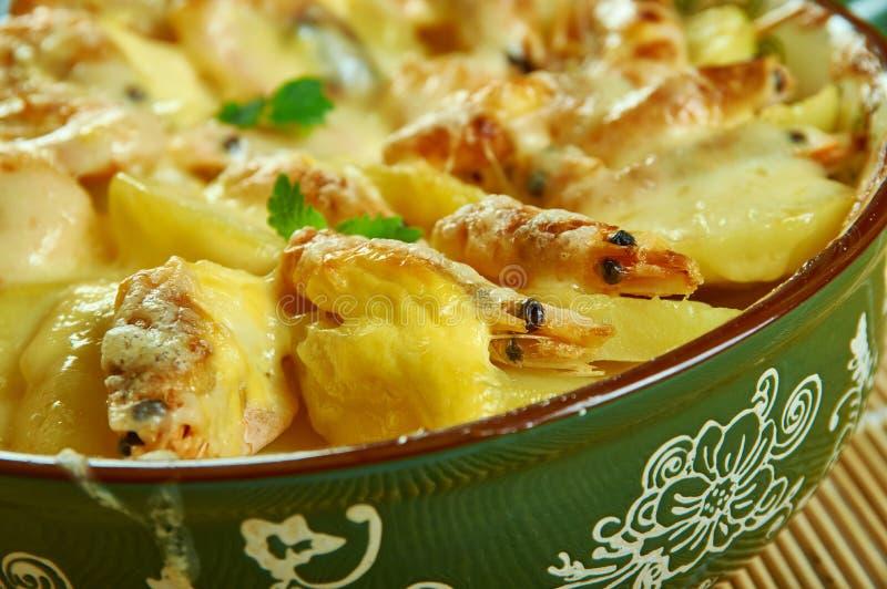 Portuguese Shrimp  Potato Gratin. De batatas gratinadas com camarao royalty free stock photography
