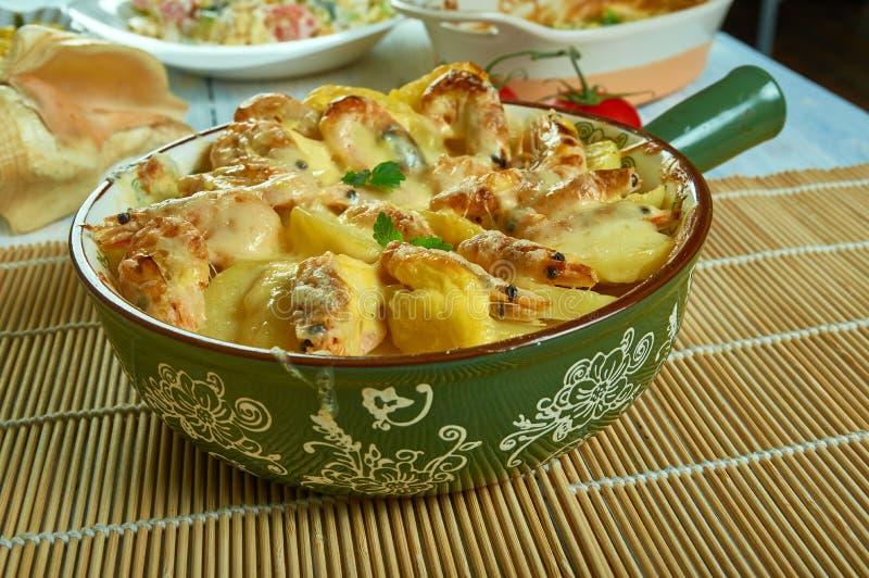 Portuguese Shrimp  Potato Gratin. De batatas gratinadas com camarao royalty free stock image