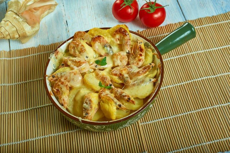 Portuguese Shrimp  Potato Gratin. De batatas gratinadas com camarao stock photos