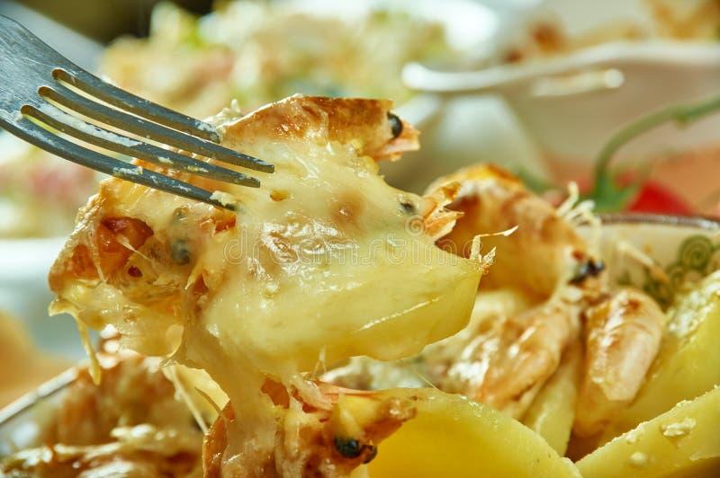 Portuguese Shrimp  Potato Gratin. De batatas gratinadas com camarao royalty free stock photos