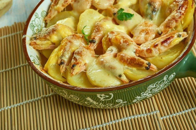 Portuguese Shrimp  Potato Gratin. De batatas gratinadas com camarao stock photo