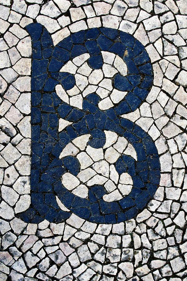 Portuguese sidewalk of calcada in the form of the letter B. Lisbon, Portugal stock photos