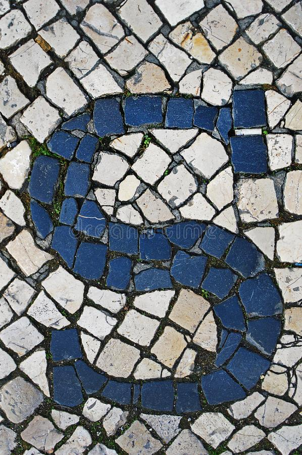 Portuguese sidewalk of calcada in the form of the letter S. Lisbon, Portugal stock photo