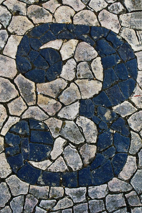 Portuguese sidewalk of calcada in the form of the number 3. Lisbon, Portugal stock images