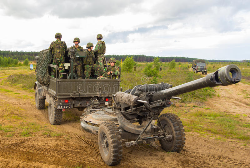 Portuguese soldiers stands on a military truck with a field howitzer stock photos