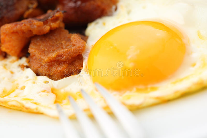 Portuguese traditional fried meat sausage with egg royalty free stock photography