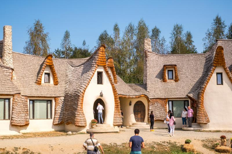 Fairytale clay castle of Porumbacu village. Porumbacu Village, Romania - 14 September 2019. people visiting Clay Castle of the Fairy Valley in Porumbacu de Sus royalty free stock photography
