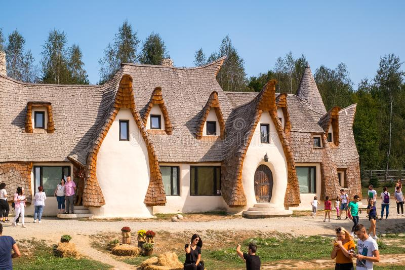 Fairytale clay castle of Porumbacu village. Porumbacu Village, Romania - 14 September 2019. people visiting Clay Castle of the Fairy Valley in Porumbacu de Sus royalty free stock photo